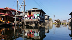 Traditional local floating village on Inle Lake, Myanmar Stock Footage