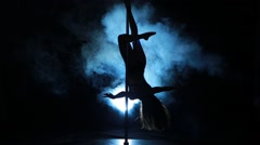 1of23 Silhouette of a sexy female pole dancing - stock footage