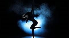 2of23 Silhouette of a sexy female pole dancing - stock footage
