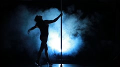 5of23 Silhouette of a sexy female pole dancing Stock Footage