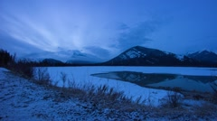 Clouds moving over Vermillion Lake at dawn - stock footage