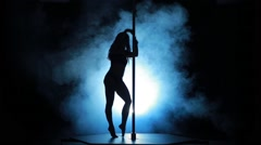 18of23 Silhouette of a sexy female pole dancing - stock footage