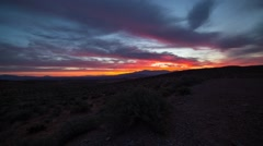 Sunrise in the Nevada desert with clouds movement Stock Footage