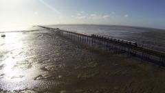Southend pier train - pull back Stock Footage