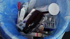 Throwing empty medicine packings trash, used expired medicaments, click for HD - stock footage
