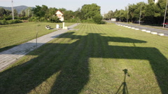 Shadow of plane monument move over grass. Timelapse. Kraljevo. Serbia Stock Footage