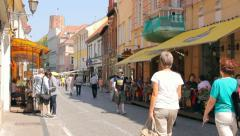 Pilies street with people in the old town of Vilnius, Gediminas' Tower Stock Footage