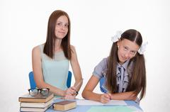the teacher tells student how to solve problem - stock photo