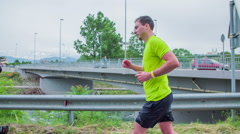 Stock Video Footage of Competitor running near river bridge