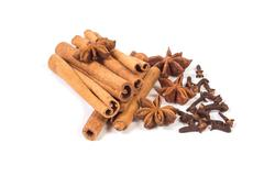 cinnamon sticks with anise stars and dry cloves - stock photo