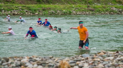 Team of people crossing the river Stock Footage