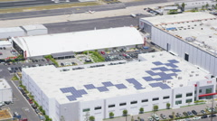 Aerial view of solar panels on warehouses Stock Footage