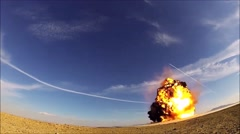 Explosion by Air Force Explosive Ordinance Disposal technicians Stock Footage
