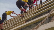Stock Video Footage of Group of people running through obstacle course