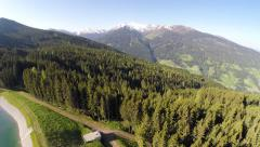 Forest & Small Lake in the Alps - Aerial Flight Stock Footage
