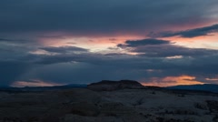 Colorful sunset clouds in the red rock desert Stock Footage