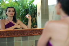 Young woman applying antiperspirant in the luxury bathroom at night NTSC Stock Footage