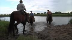 Cowboys on Horses Crossing River 1 Stock Footage