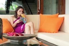 Woman smartphone drink sofa luxury home K NTSC Stock Footage