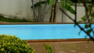 Stock Video Footage of Swimming Pool in Bad Weather under Rain.