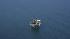 Aerial view of California oil rig platform - stock footage