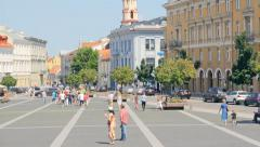 Vilnius Town Hall with a lot of historical buildings, people walk Stock Footage