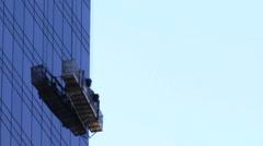 Window Washers Scaffolding  on a Office Building HD Stock Footage