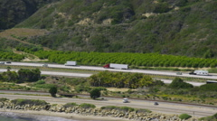 Aerial view of trucks on a highway - stock footage