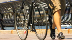 Man with Bicycle and Brooklyn Bridge HD Stock Footage