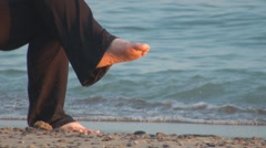 Close up of woman feet and black pants at lake beach 2 Stock Footage