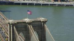 Aerial view of Brooklyn Bridge and American USA Flag Stock Footage