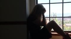 Desperate Woman in Window Stock Footage