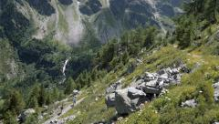 Hikers in alpine valley - stock footage