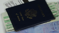 Passports & Airplane Ticket Rotating Zoom Out HD Stock Footage