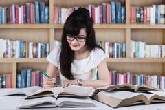 Student studying at library Stock Photos