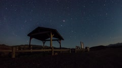 Moonset lights and milky way rising Stock Footage