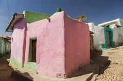 Pink house in narrow alleyway of ancient city of jugol in the morning. harar. Stock Photos