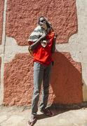 Harar, ethiopia - december 24, 2013: unidentified young man posing in typical Kuvituskuvat