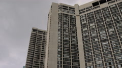 Stock Video Footage of Establishing shot of a typical high-rise apartment building.