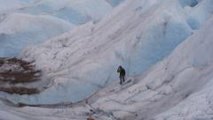 Panning of Climber Walking by Deep Cliff HD Stock Footage