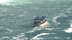 The boat Maid of Mist in the middle of the Niagara Falls Stock Footage