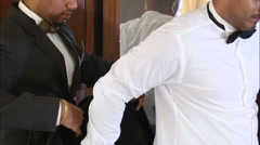 witness helps the groom to wear - stock footage
