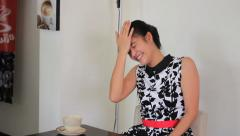 Pretty Asian Woman Laughing Hysterically In Cafe - stock footage
