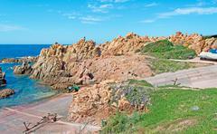 rocky shore in costa paradiso - stock photo