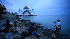 Photographers at Malacca Straits Mosque waiting for the sunrise Stock Footage