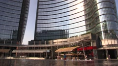 Child playing in the fountain near the Unicredit skyscraper Stock Footage