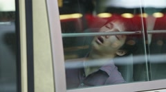HONG KONG, CIRCA 2014: Asian tired sleeping man in the city bus Stock Footage