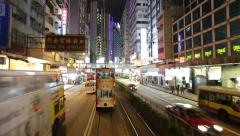 HONG KONG ISLAND, CIRCA 2014: City tram fast moving through the streets. POV Stock Footage