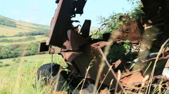 Large rusty vechicle behind long grass 4 Stock Footage