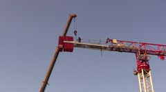 Worker on crane Stock Footage